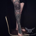 White on Black Mehendi Leg tattoo