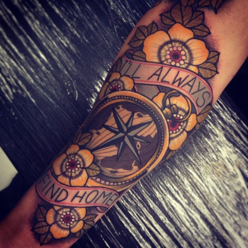 Tom Bartley compass tattoo