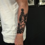 Arm Ship in Bottle tattoo