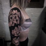 Black Background White Flowers Tattoo Sleeve
