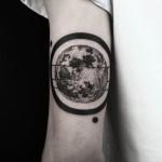 Black Ring Dotwork Planet Tattoo on Arm
