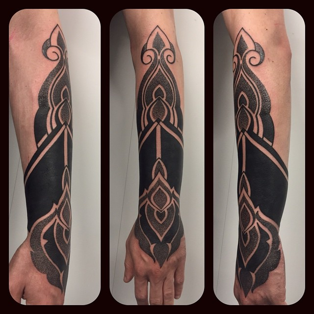 Black and Dotwork Arm Tattoo