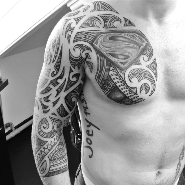 Chest and Sleeve Maori Superman Tattoo