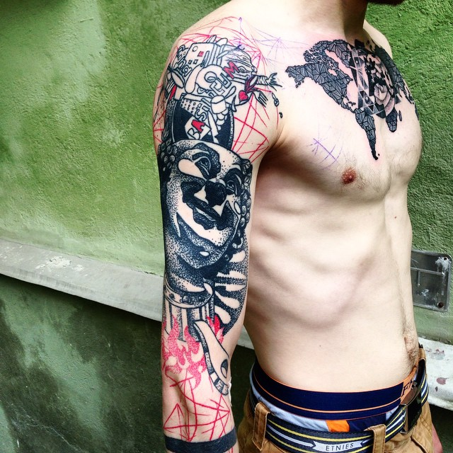 Chest and Sleeve Trash Polka Tattoo