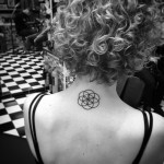 Circles on Circles Back Neck Tattoo