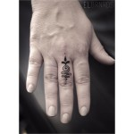 Cute Hindu Ornament Small Tattoo on Finger