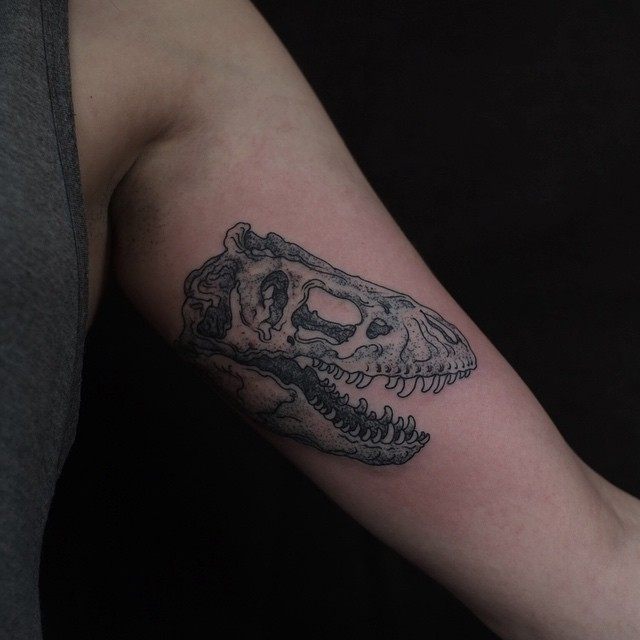 Dinosaur Skull tattoo on Arm
