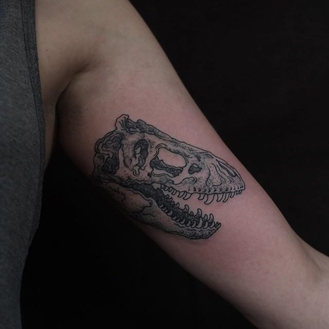 Dinosaur Skull tattoo on Arm