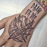 Draw or Die Hand Tattoo