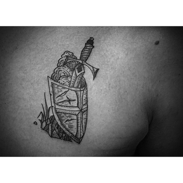 Etching Shield and Sword tattoo