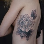 Flower Outlines Rib Tattoo