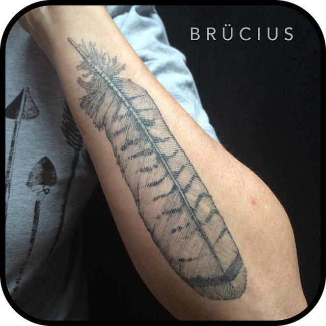 Graphic Big Feather tattoo on Arm