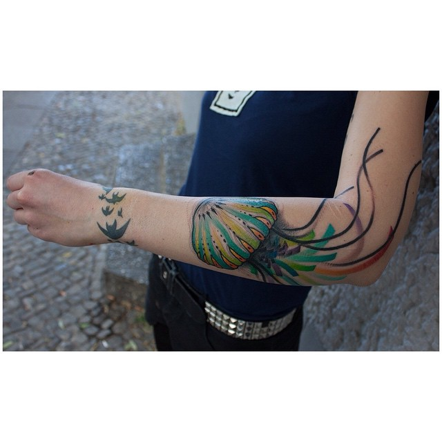 Green Jelly Fish Tattoo on Arm