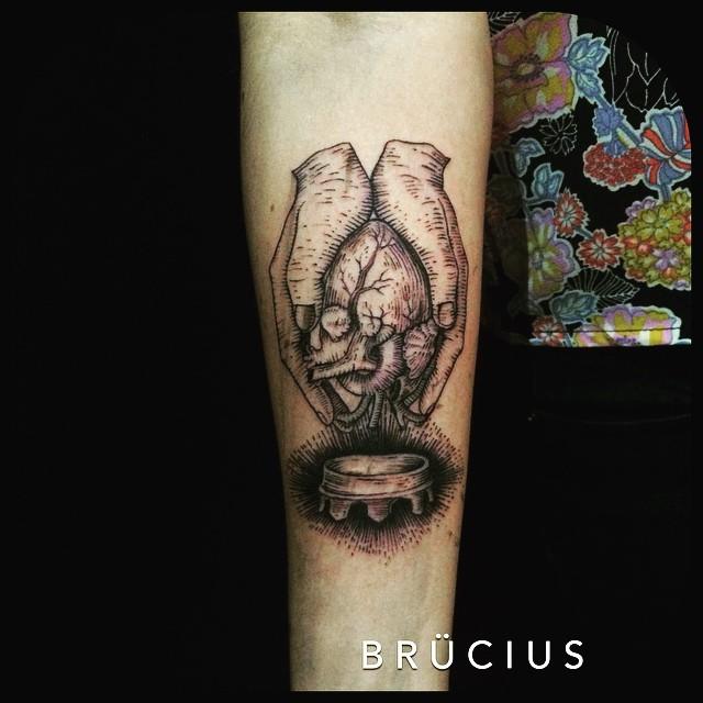 Hands Holding Heart Tattoo
