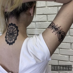 Neck and Arm Blackwork Tattoo