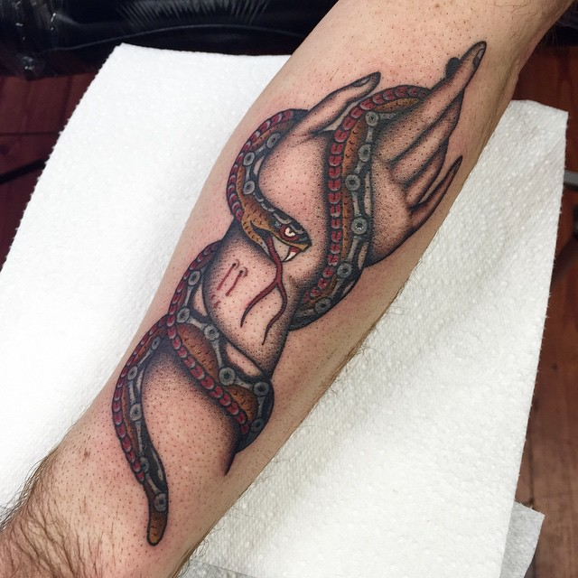 Snake Sting Hand tattoo on Arm