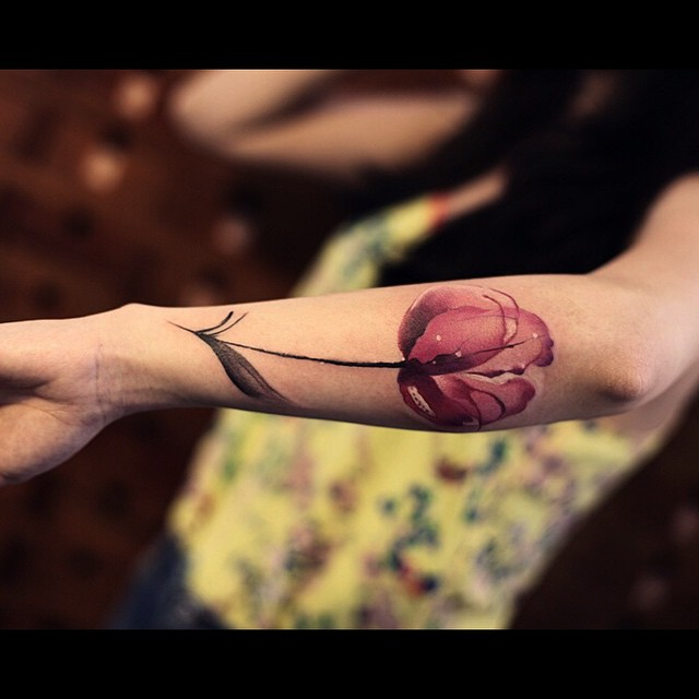 Tender Pink Flower Tattoo on Arm