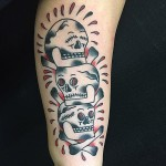 Three Skulls Tattoo on Arm