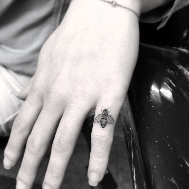 Tiny Bee Tattoo on Finger