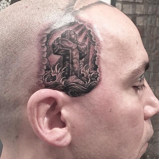 Water Crucifix Head Tattoo
