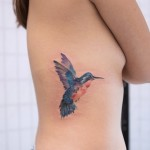 Watercolor Humming Bird Tattoo on Side