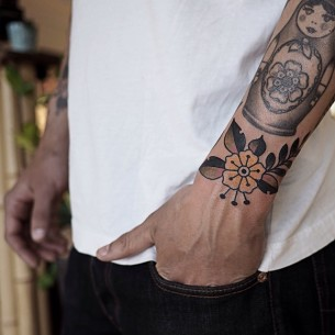Yellow Traditional Flower Wrist tattoo