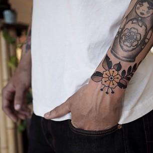 Yellow Traditional Flower Wrist tattoo