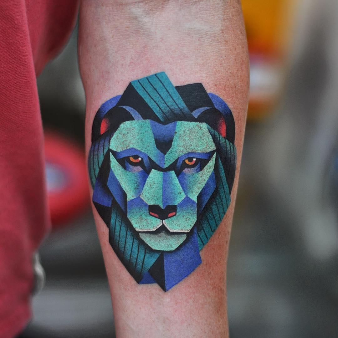 Blue Lion Tattoo on Arm