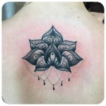Graphic Baroque Lily Tattoo on Back