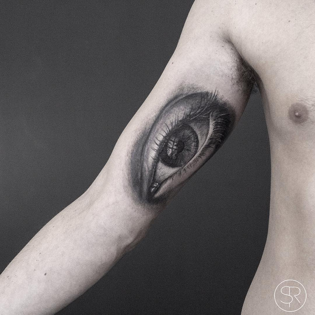 Graphic Realistic Eye Tattoo on Arm
