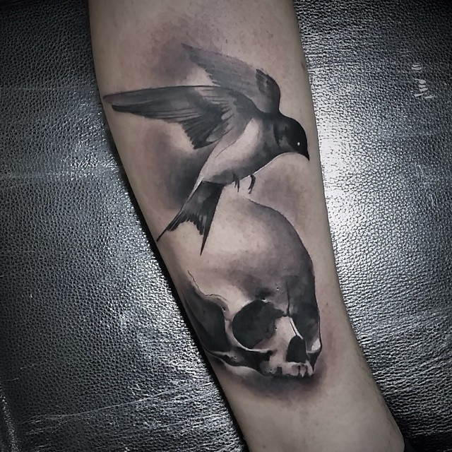Graphic Skull and Bird Tattoo
