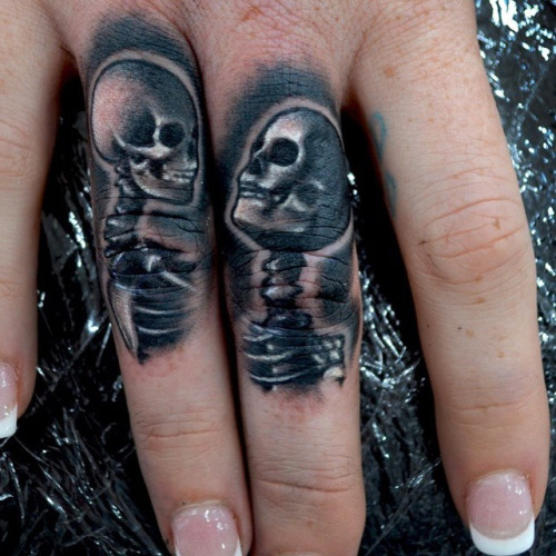 Skeleton love Finger Tattoo