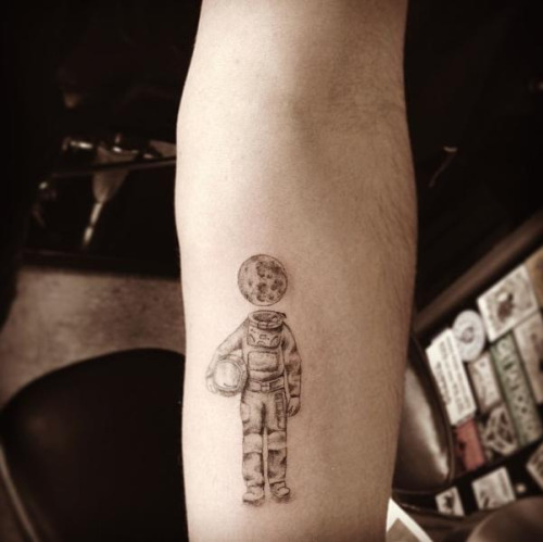 Astronaut small tattoo