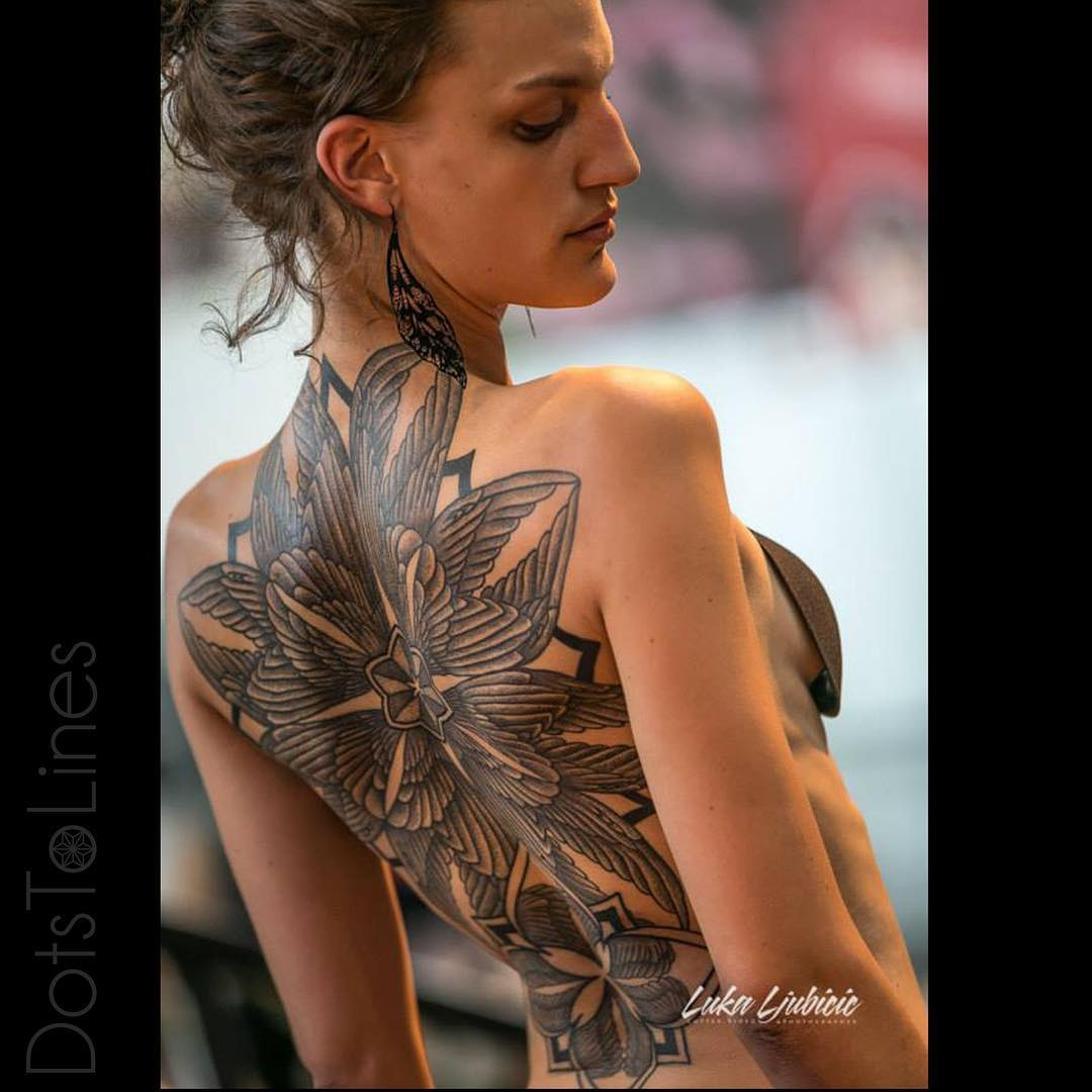 Traditional full back tattoo of flower