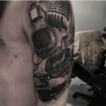 Graphic Headphones Tattoo on Shoulder