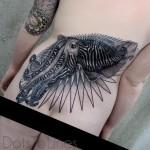 Lower Back Squid Tattoo