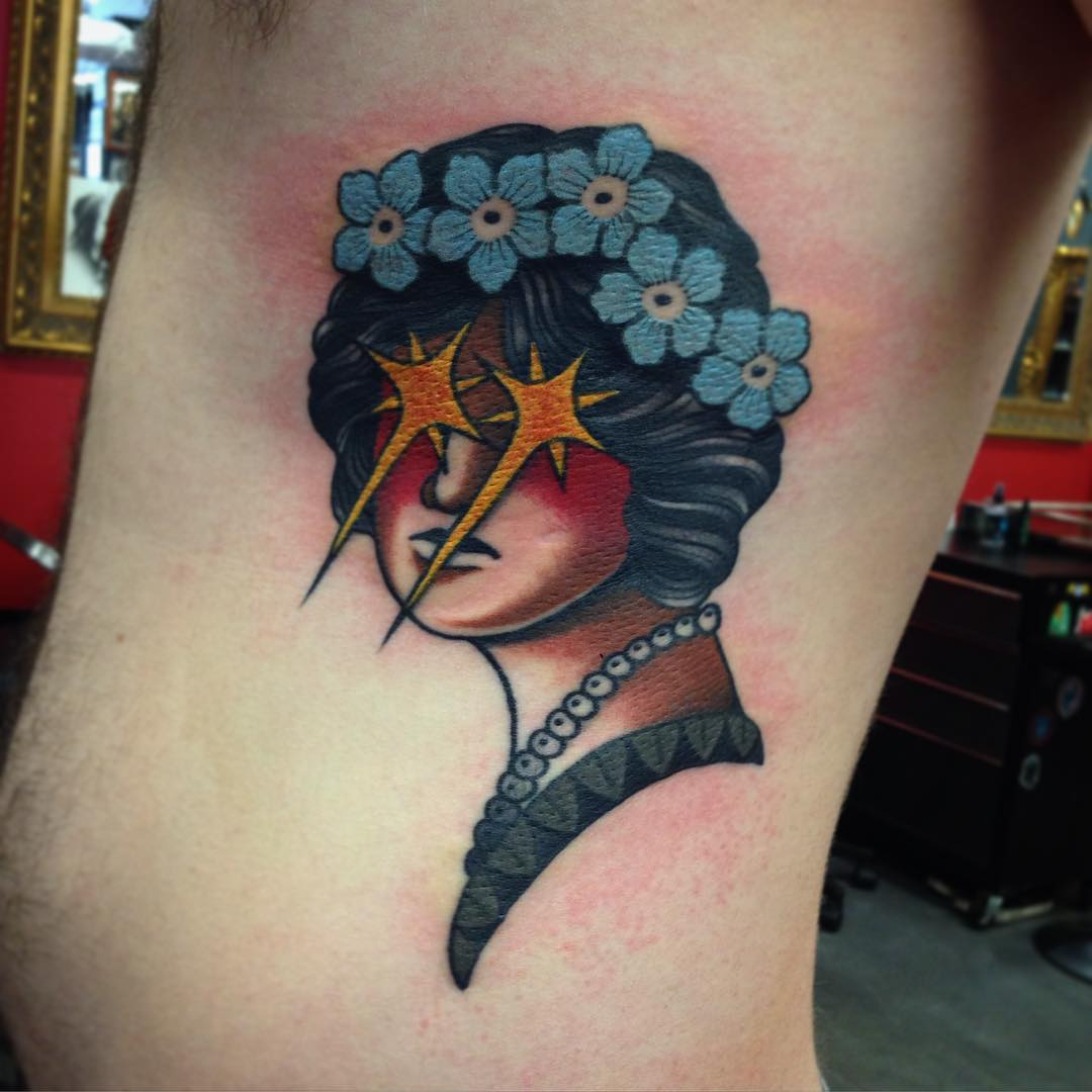 Sparkle Eyes Girl Tattoo on Ribs