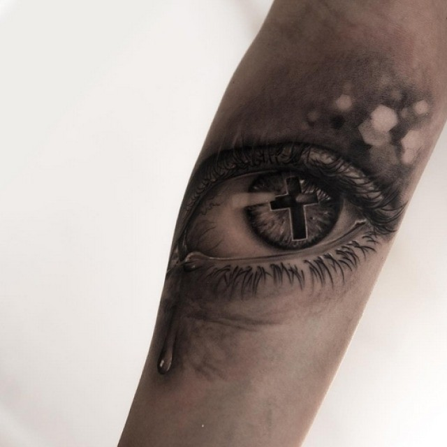 Tear tattoo under eye best tattoo ideas gallery for Cross tattoo under left eye meaning
