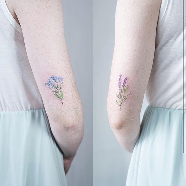matching flowers tattoo by Sol Art