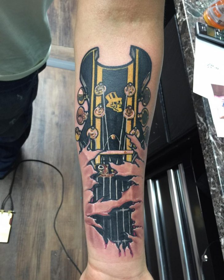 rock guitar tattoo
