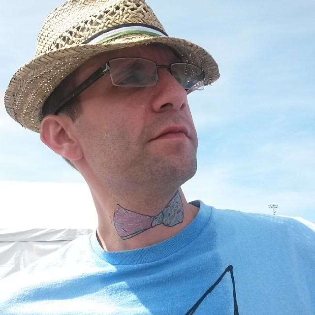 man bowtie tattoo