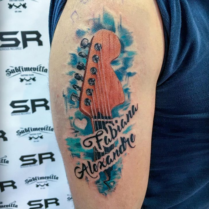 arm guitar tattoo