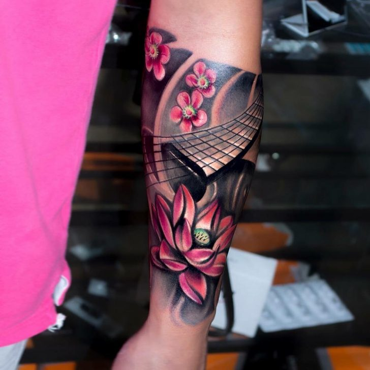 flowers and guitar tattoo