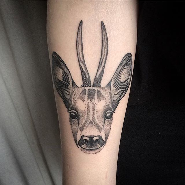 very decent tattoo of a deer. tattoo on arm