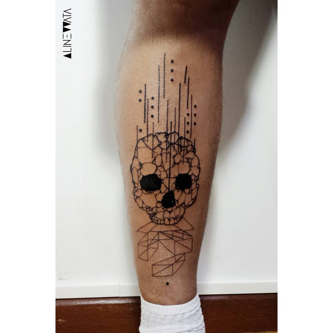 Falling Skull Tattoo on Calf