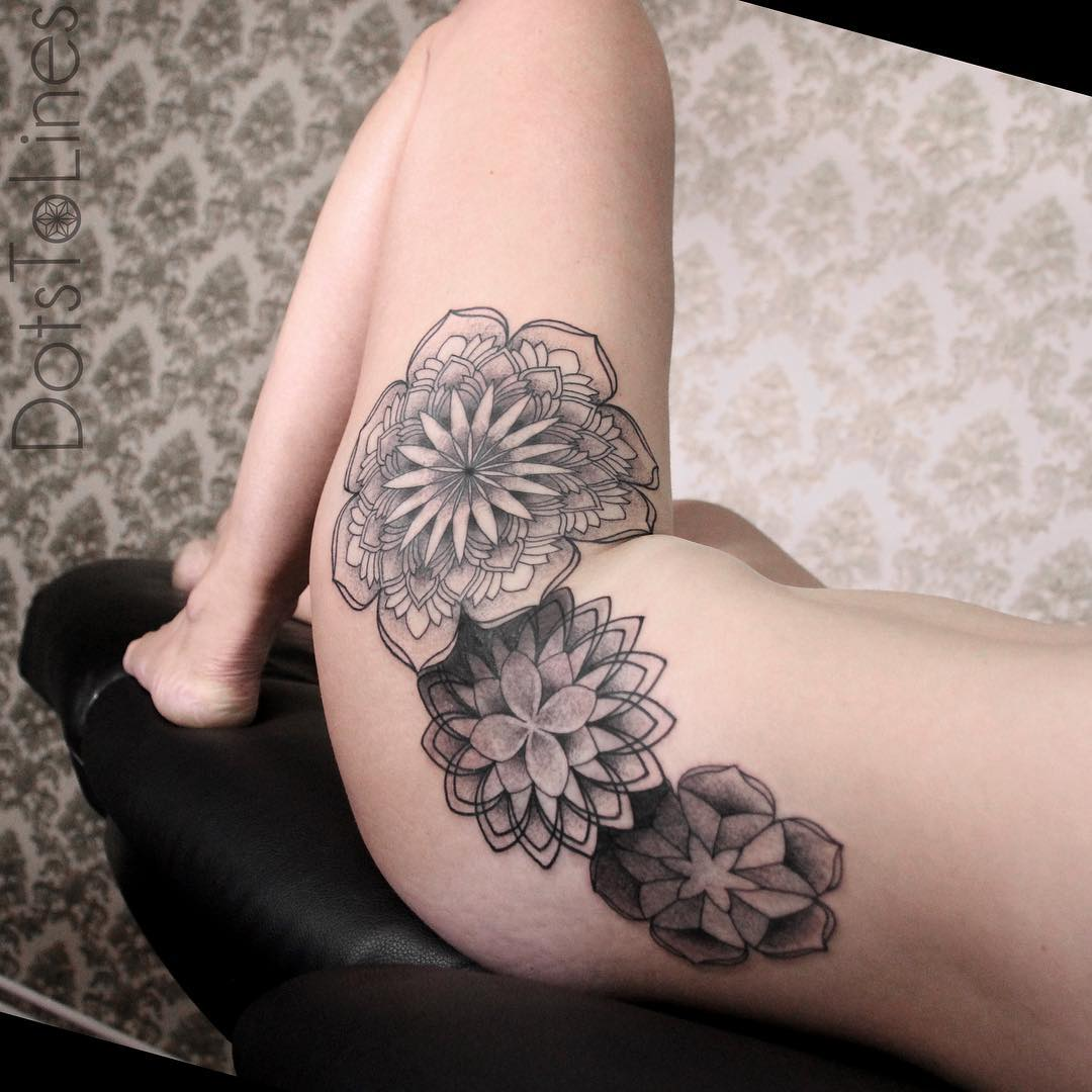 girl's hip decorated with several beautiful mandala tattoos