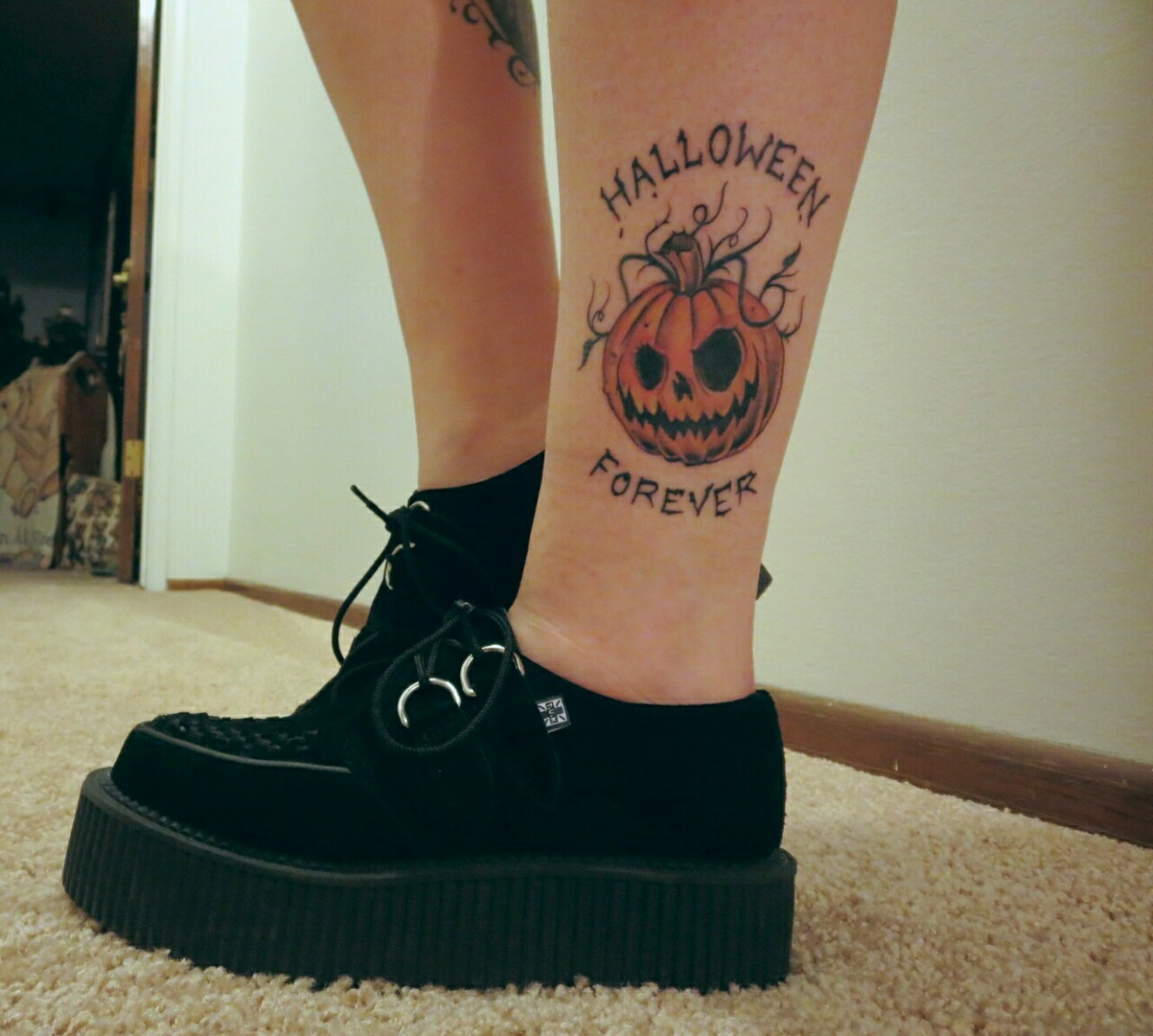Pumking on leg with lettering