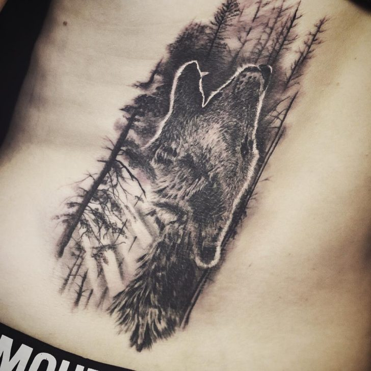 wolf in forest tattoo by Dmitri Skribans