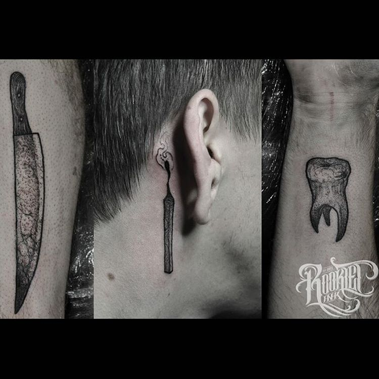 several small tattoos behind the ear