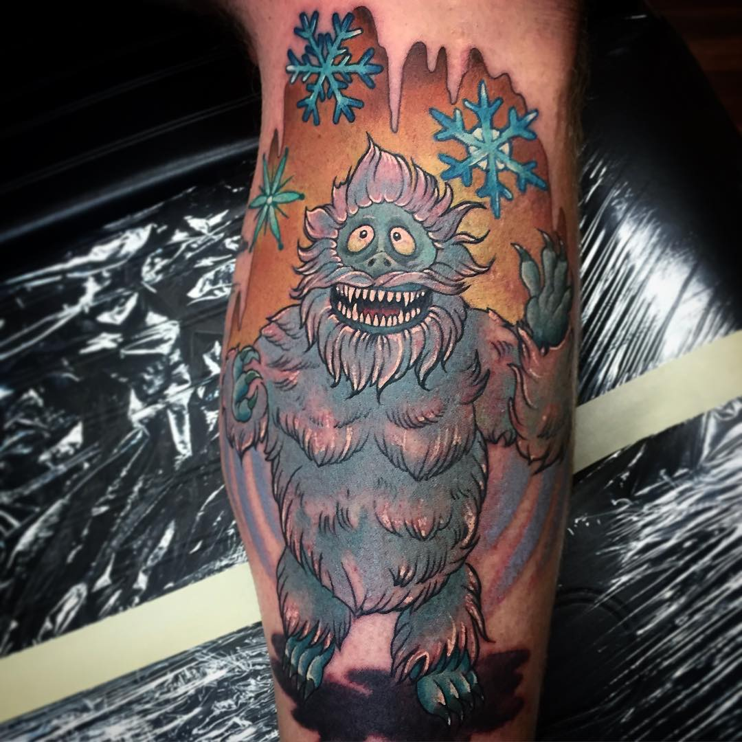 funny new school tattoo of a bigfoot